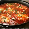 Shakshuka: Israeli dish of eggs poached in a spicy tomato sauce