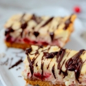 Holiday Cranberry Cheesecake Bars with Chocolate Drizzle