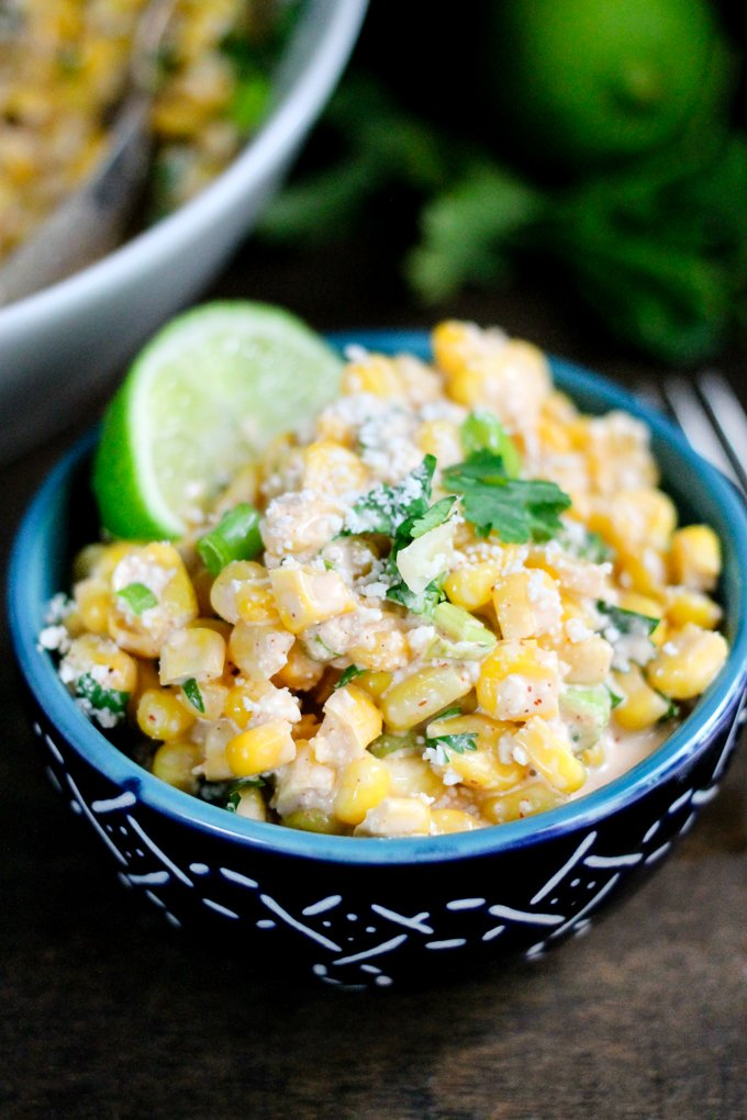 Mexican Street Corn Salad is a take on the popular Elotes recipe; delicious corn smothered in a spicy dressing and topped with vibrant pops of flavor!