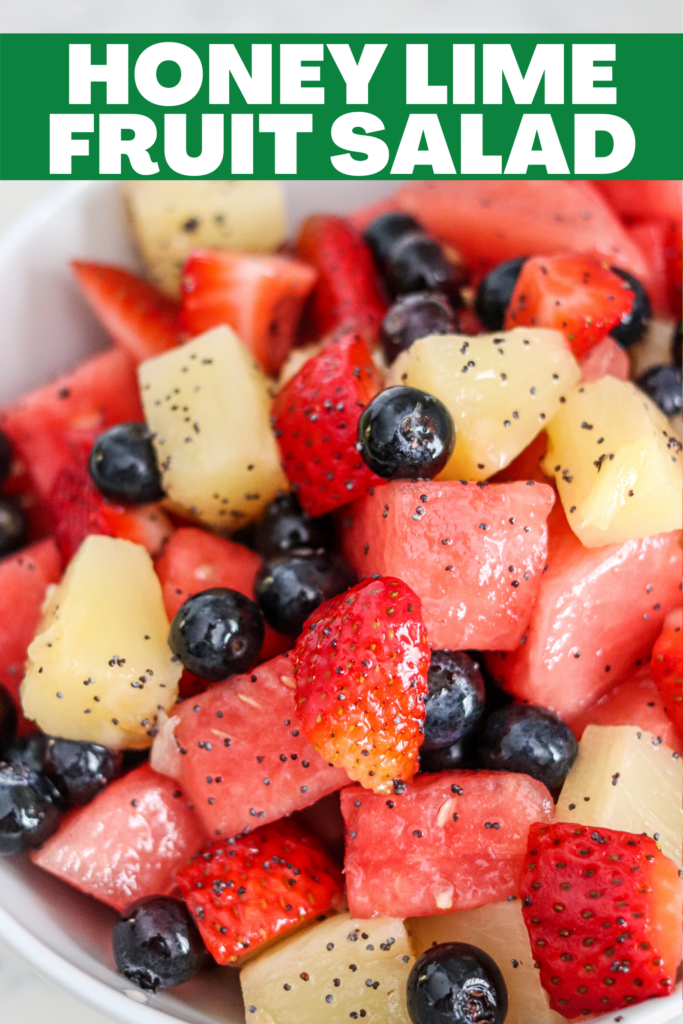 This vibrant fruit salad is filled with berries, pineapple, and watermelon, and then coated in a delicious honey lime poppyseed glaze! It's easy and delicious!
