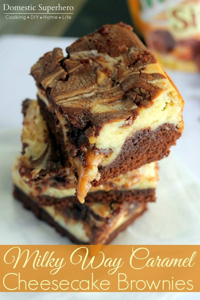 Milky Way Caramel Cheesecake Brownies are stuffed with delicious creamy cheesecake and dripping with ooey gooey caramel! These will be a hit at your next party!