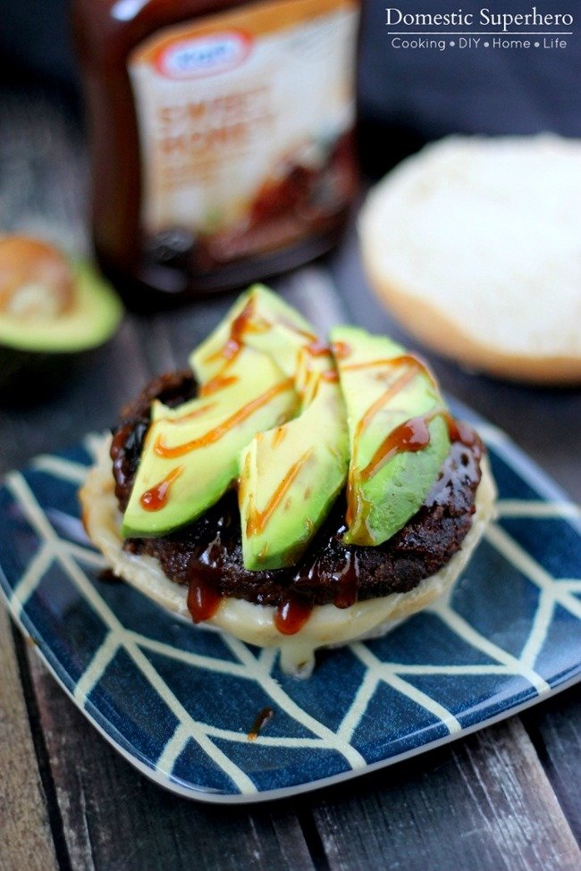 Spicy Black Bean Barbecue Avocado Burgers are spicy yet sweetened up with delicious honey BBQ sauce! Topped with a fresh avocado and pepper jack cheese - these are the perfect burgers!