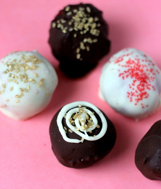 Oreo Bomb Truffles are Delicious oreo crumbles mixed with creamy cream cheese and coated in a chocolate shell.