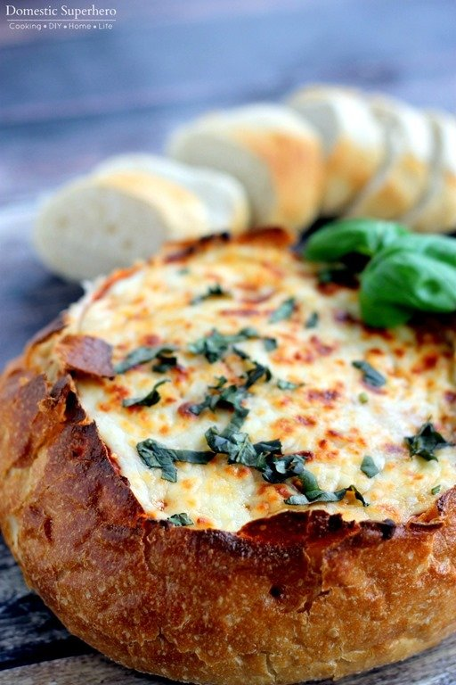 Cheesy Pizza Dip Bread Bowl - the cheesiest, most delicious 'dip' you...