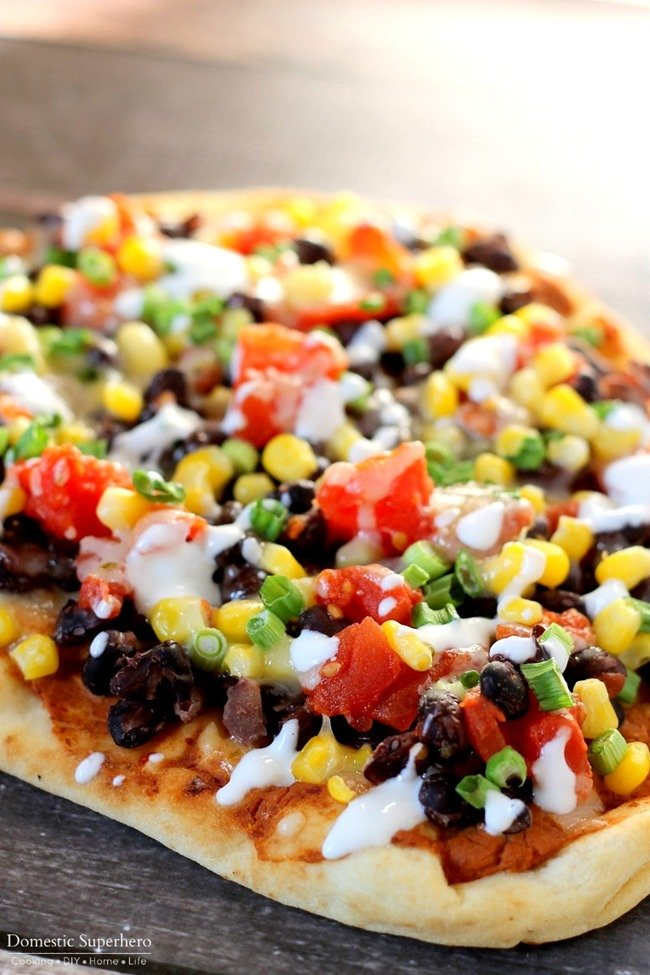 Southwestern Flatbreads : Naan topped with creamy chipotle bean spread, black beans, tomatoes, corn, pepper jack cheese, & delicious lime cream. Delicious and Easy!