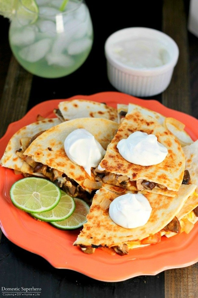 Veggie Fajita Quesadillas are full of fresh peppers, mushrooms, and tomatoes, then grilled up for a delicious filling meal!