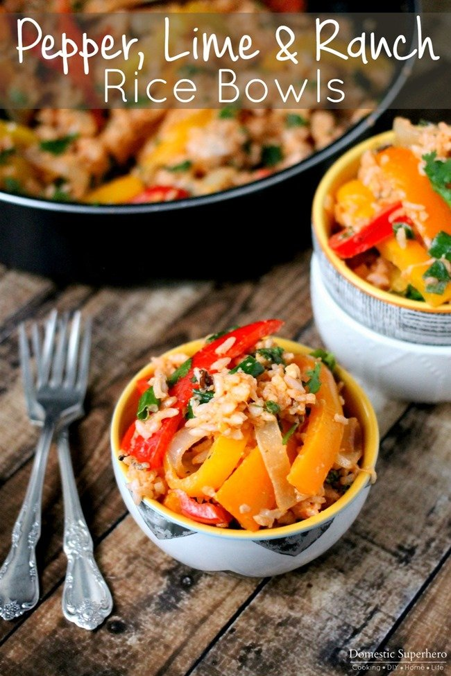 One Pan Pepper, Lime, & Ranch Rice Bowls are filled with delicious red, yellow, and orange peppers, onions, fresh lime juice, cilantro, green onions, and RANCH! Perfect one pot dinner!