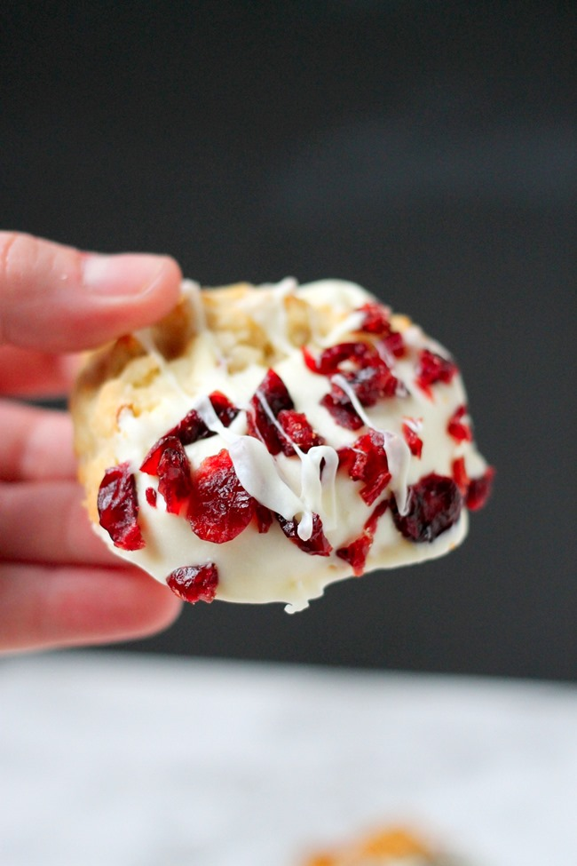 Cranberry White Chocolate Macadamia Nut Cookies - delicious soft baked macadamia nut cookies, dipped in white chocolate and coated with cranberries. These are the BEST holiday cookies!