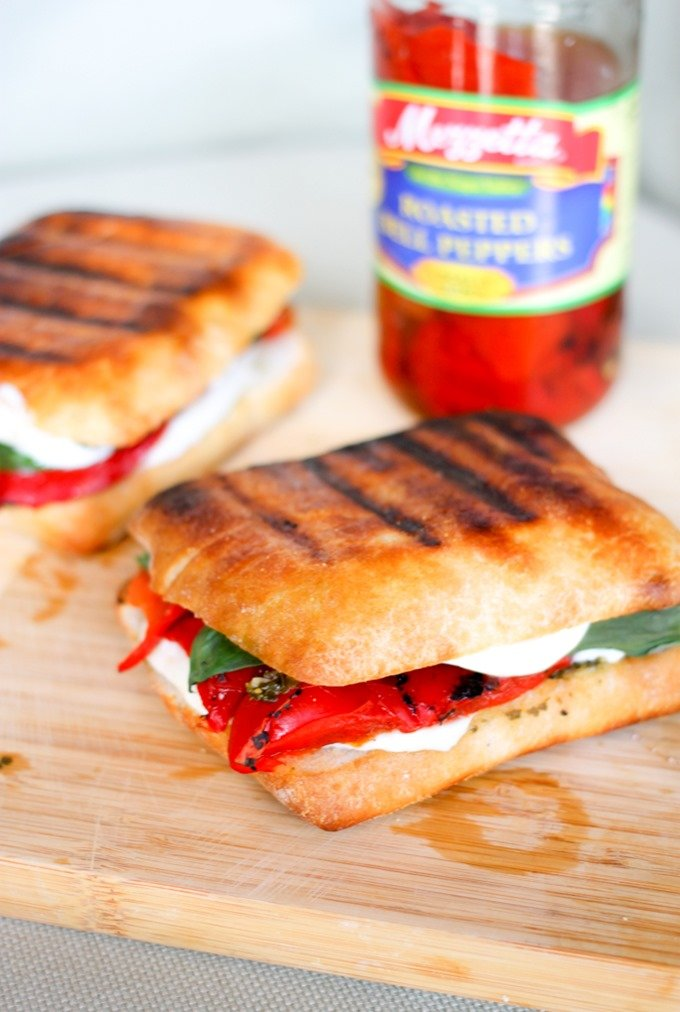 Roasted Red Pepper Grilled Cheese is filled with basil pesto fresh mozzarella, and roasted red peppers. It is the perfect summer sandwich!