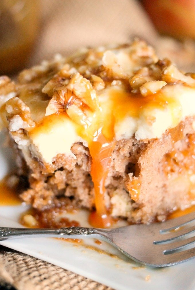 Caramel Apple Poke Cake is packed with apples and then smothered in whipped cream and caramel. It's the easiest most delicious fall cake!