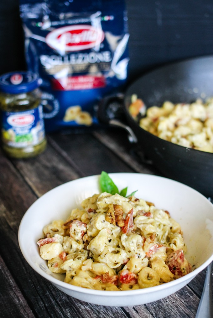 One Pot Cheesy Pesto Tortellini is the easiest and tastiest weeknight meal - tender tortellini and tomatoes drenched in a creamy cheesy pesto sauce!