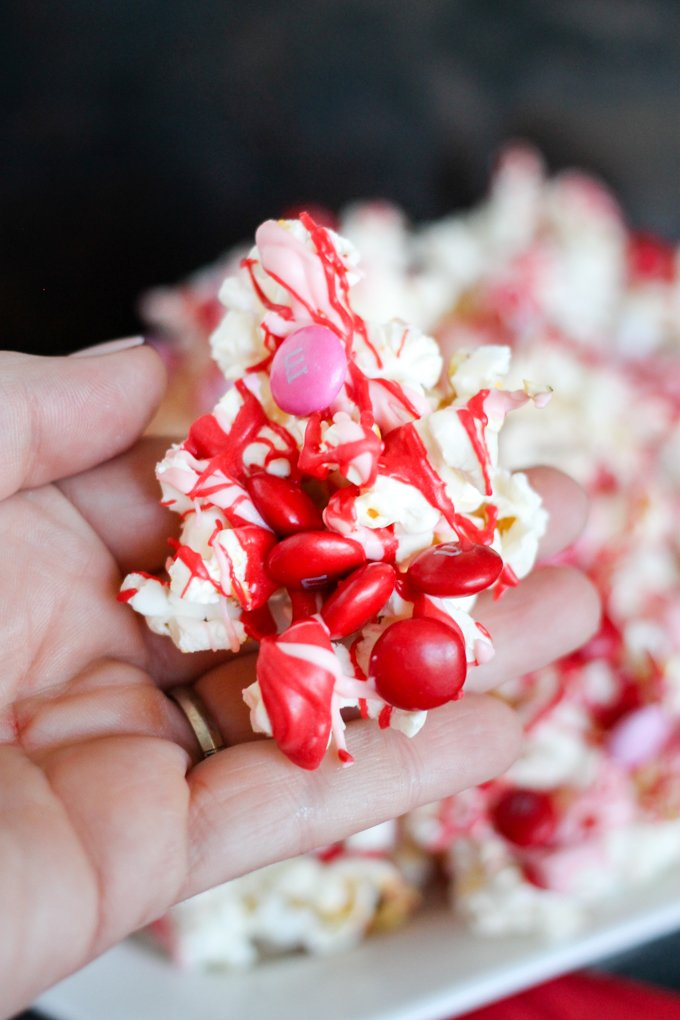 Valentine's Day Chocolate M&M Popcorn is going to be the star of your Valentine's Day Party! Only THREE ingredients and only minutes to toss together!