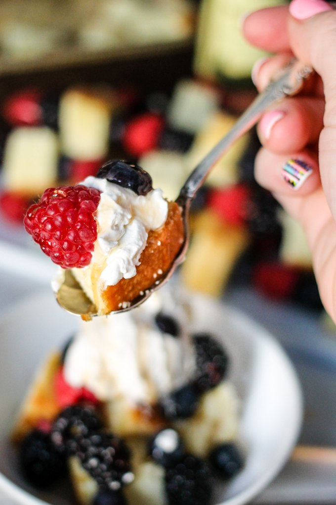 Three Berry Shortcake Skewers are stacked with delicious juicy berries and pound cake, then drizzled with a sweet balsamic reduction and topped with whipped cream!