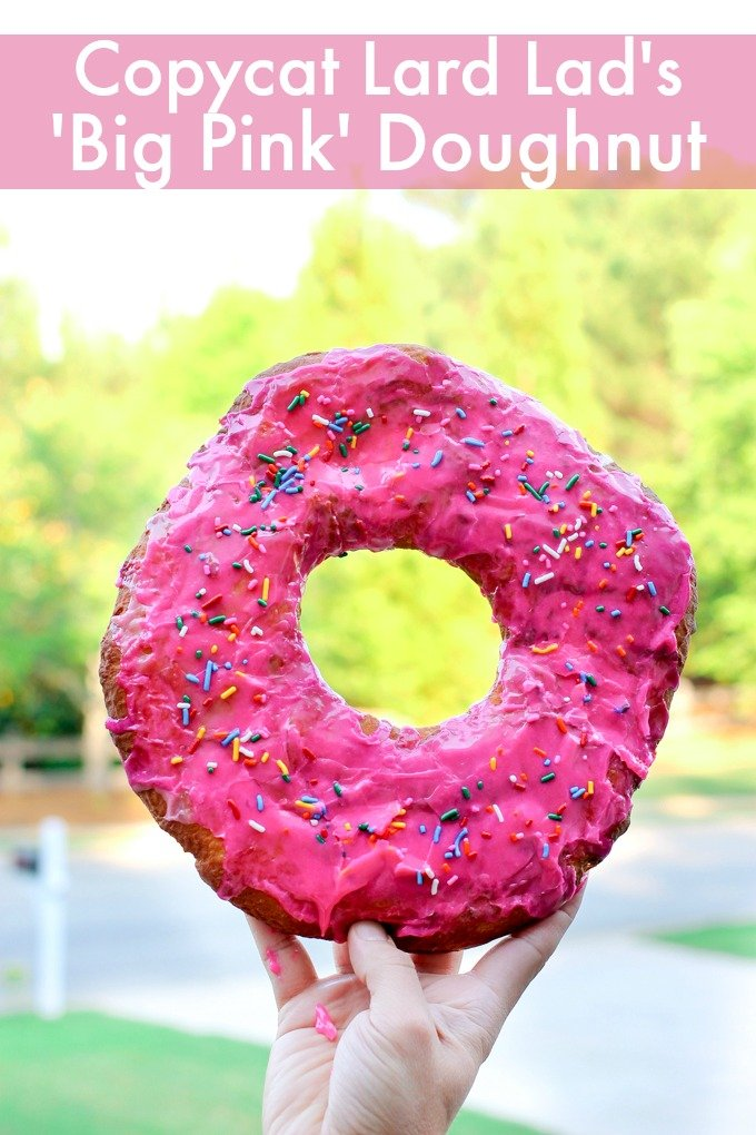 This Copycat Lard Lad's Big Pink Doughnut is a GIANT fried doughnut drenched in pink glaze and topped with rainbow sprinkles! It's delicious!