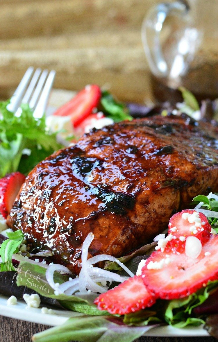 Strawberry Balsamic Glazed Chicken on a plate with a fork.