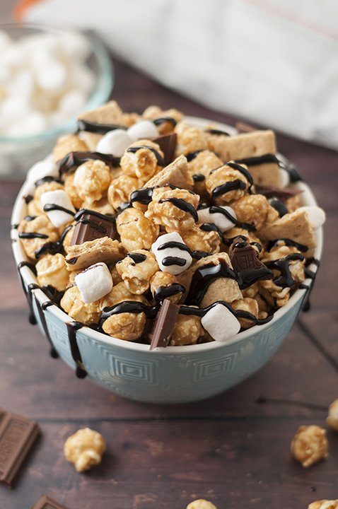 S'mores Caramel Popcorn in a blue ceramic bowl