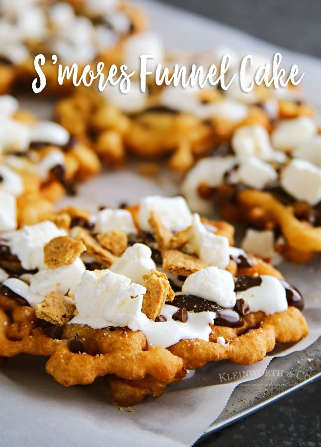 S'mores Funnel Cake on a parchment lined sheet pan