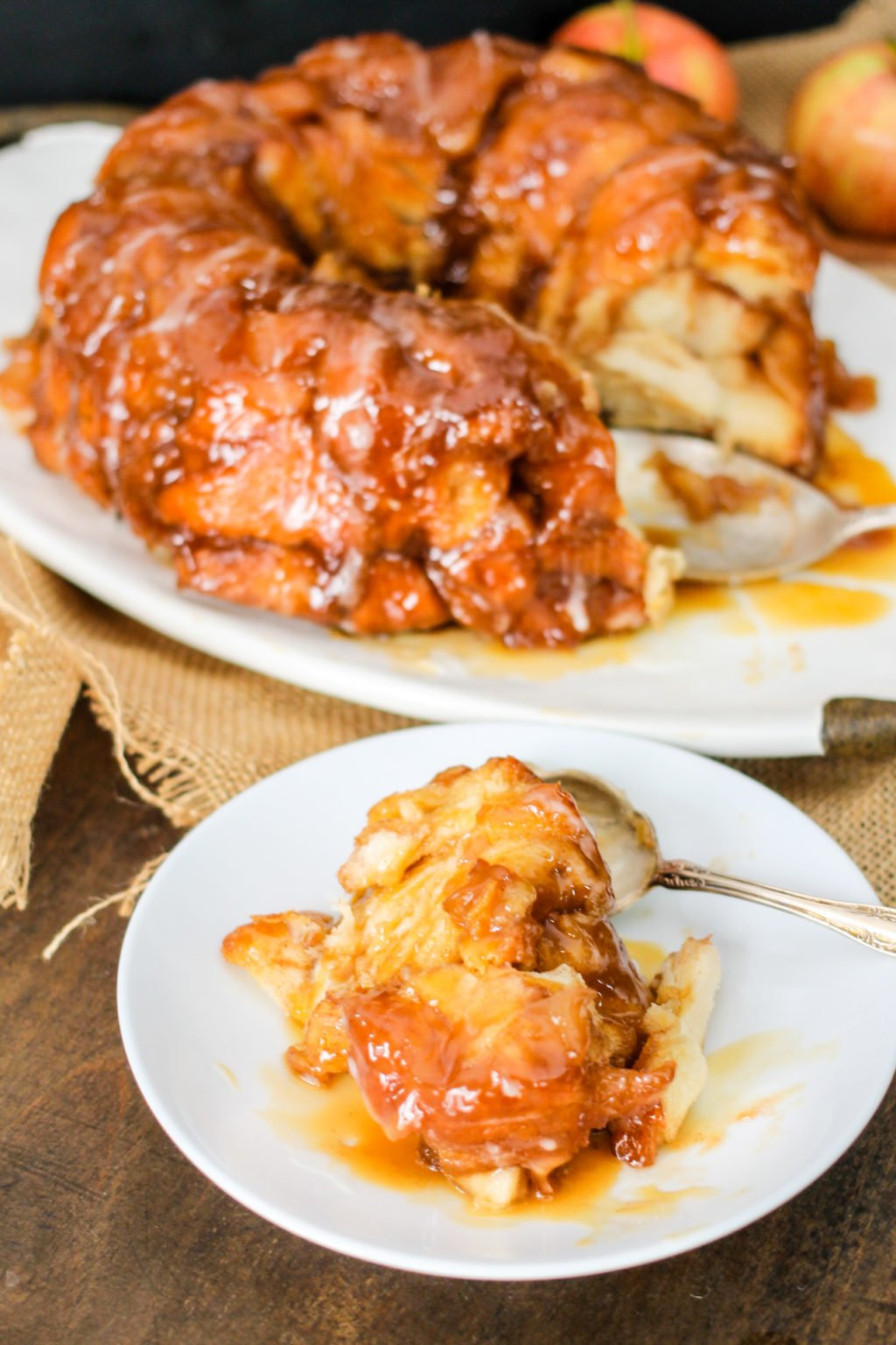 Loaded with caramel, apples, and delicious brown sugar, this Caramel Apple Monkey Bread is going to be everyone's favorite fall treat! Serve it up for breakfast or dessert!