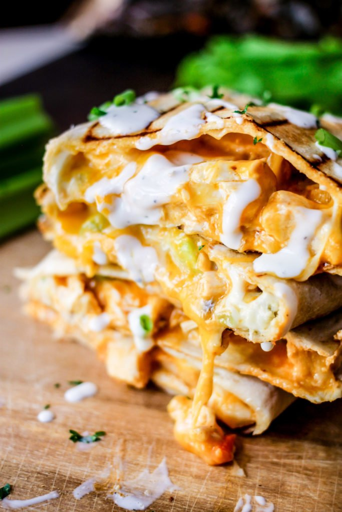 Classic buffalo chicken flavors mixed together and grilled between two crunchy tortillas makes the perfect Grilled Buffalo Chicken Quesadillas.
