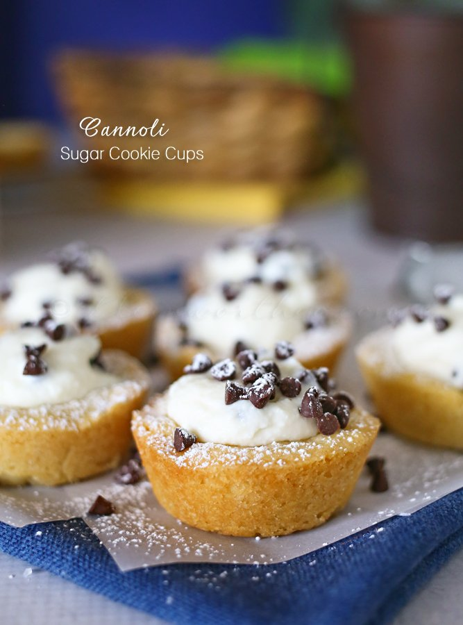 Cannoli Sugar Cookie Cups on parchment over a blue napin