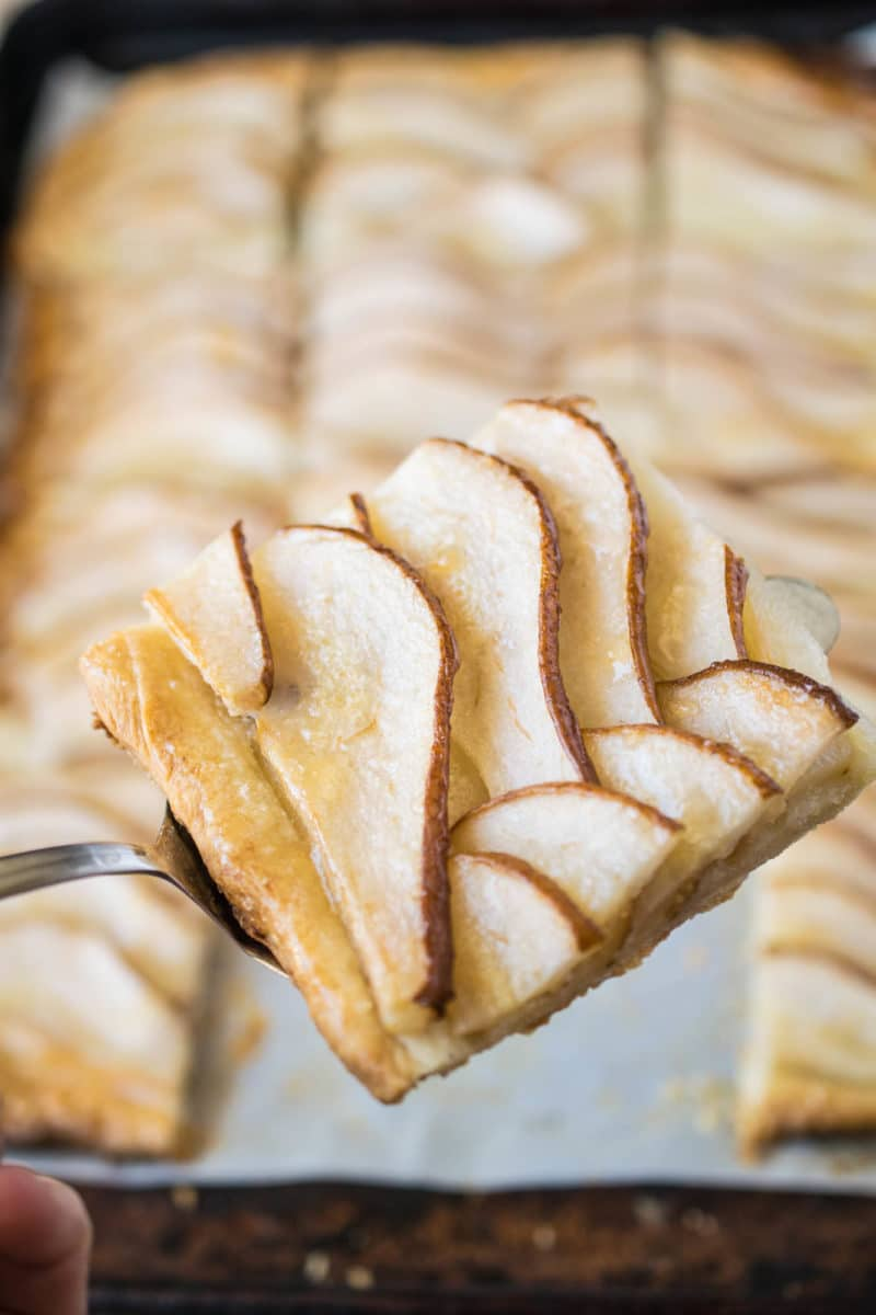 Easy pear tart slice on a serving utensil