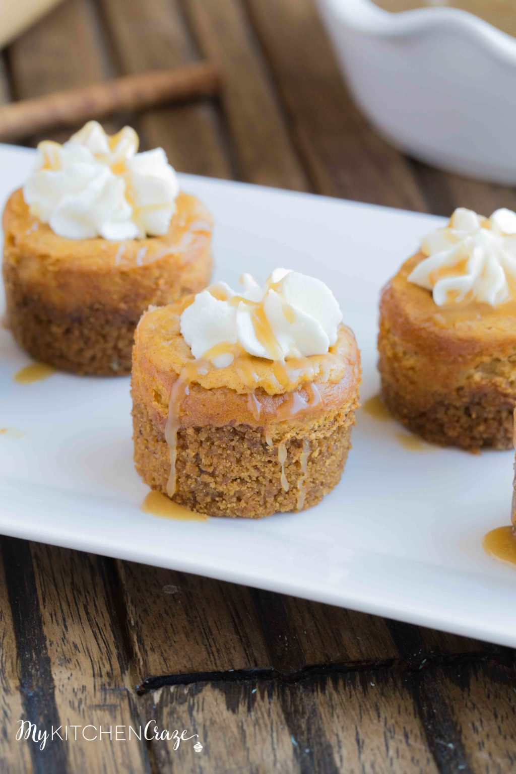Mini Pumpkin Cheesecakes on a white tray