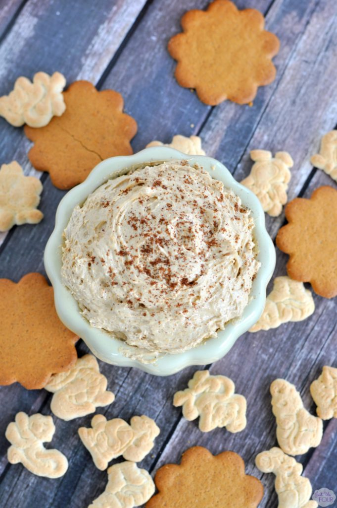 4 ingredient pumpkin pie dip in a bowl surrounded by cookies