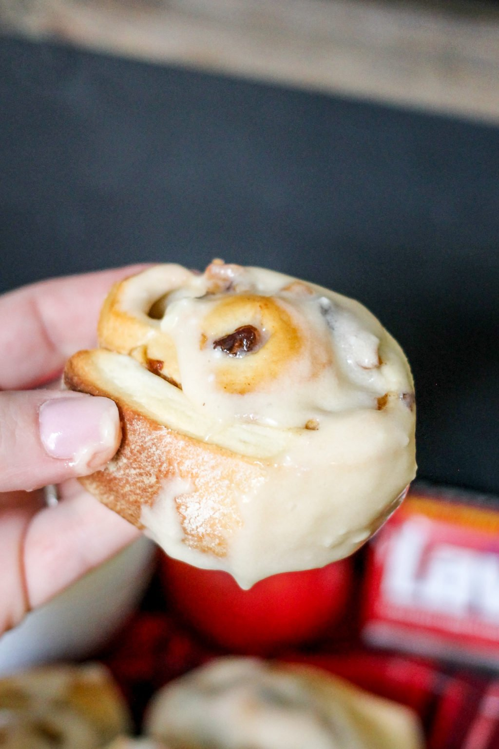 Apple Raisin Cinnamon Rolls are filled with tart apples and sweet raisins, combining the delicious flavors in the perfect breakfast treat.