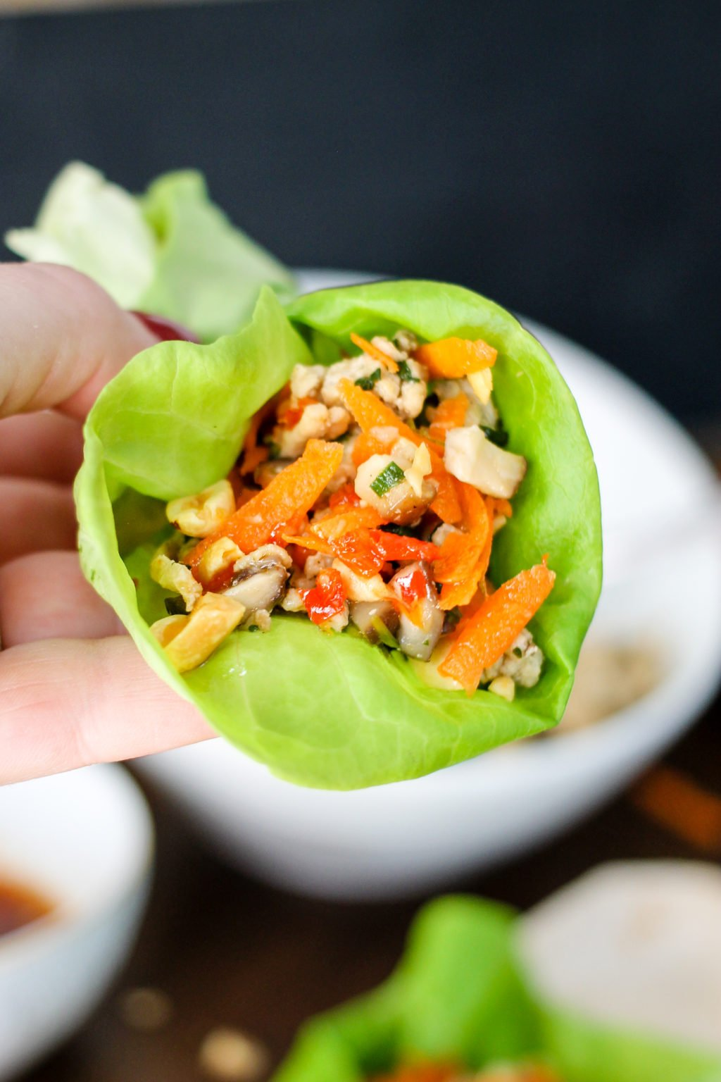 Asian Chicken Lettuce Wraps are super easy to make and taste better than the popular PF Chang's version. This healthy recipe packs all the flavor!