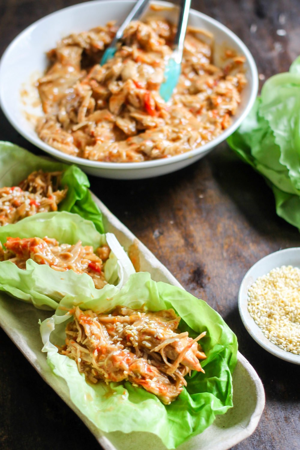 Thai Lettuce Wraps can be made with pork or chicken in the instant pot or slow cooker! Juicy pork or chicken covered in an easy Thai peanut sauce makes the perfect healthy easy dinner!