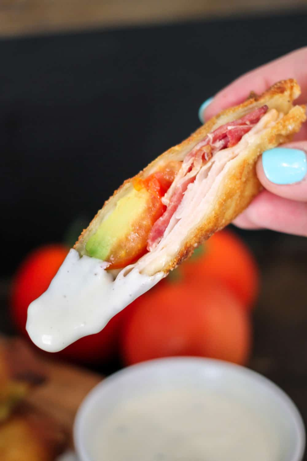 These crispy Turkey Club Egg Rolls are filled with turkey, bacon, tomato, avocado, cheese, and a special sauce! Deep fry them or make them healthier in the Air Fryer!