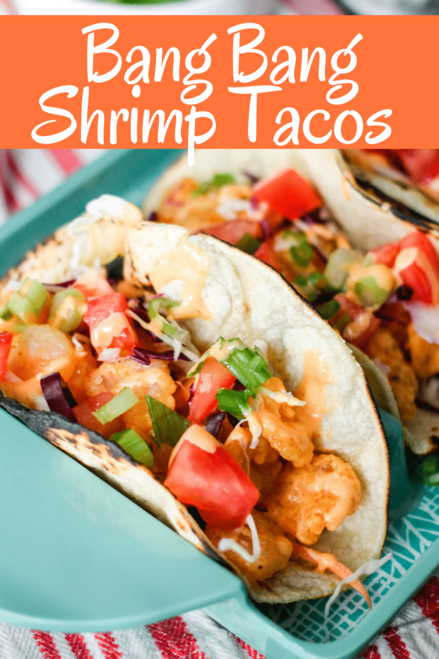 Bonefish Grill's Bang Bang Shrimp Tacos is an easy and delicious recipe that can be made at home. With the signature spicy sauce, and crunchy taco toppings, these will be your favorite Shrimp Tacos ever!