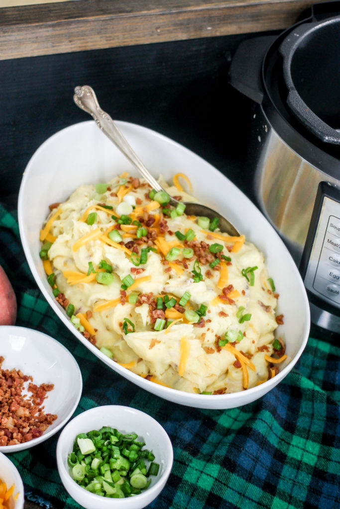 Instant Pot Loaded Mashed Potatoes are full of cheese, bacon, and green onions! Ultra creamy and delicious, these are the best loaded mashed potatoes!