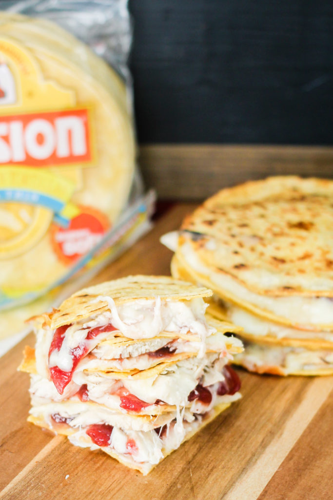 Corn tortillas filled with leftover Thanksgiving turkey, cranberry sauce, and melted cheese make these Turkey Cranberry Quesadillas the perfect day-after-Thanksgiving lunch or dinner!