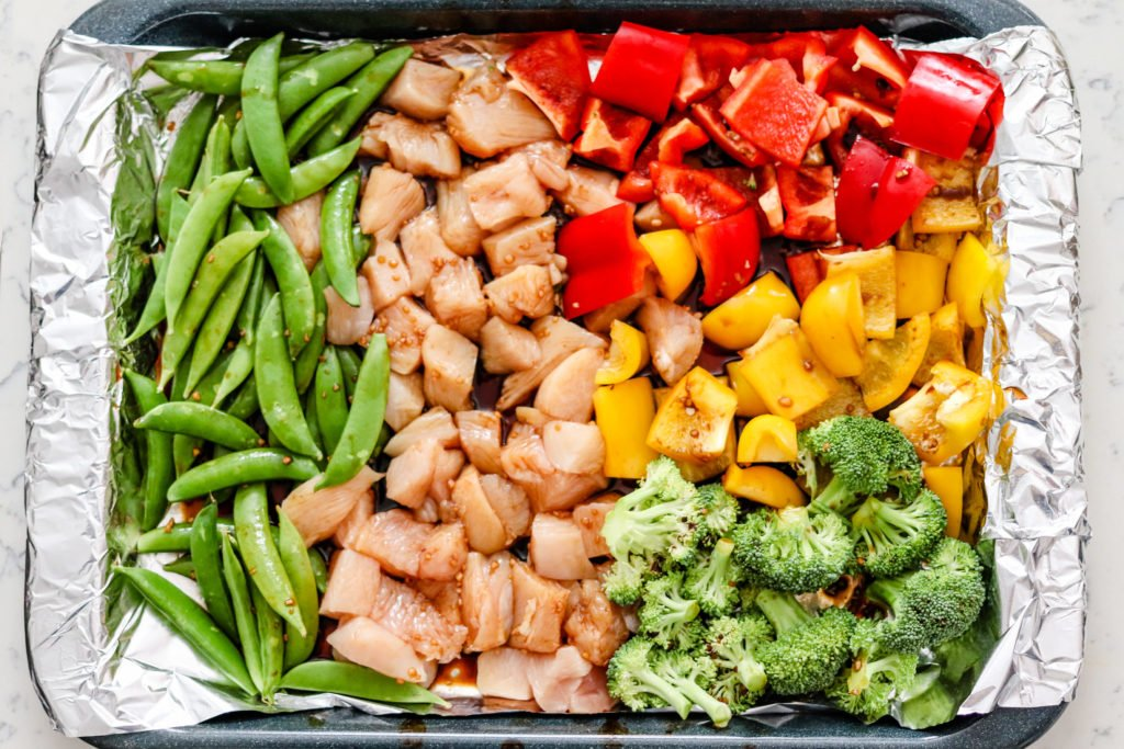 Sheet Pan Asian Chicken and Vegetables only uses one pan and makes a delicious and healthy meal. Great for meal prep and healthy eating! Only 221 calories per serving and can be doubled or tripled for easy meal prep!