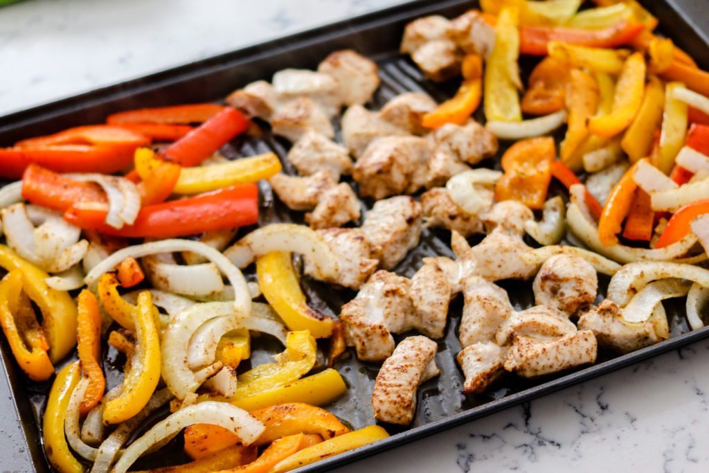 Sheet Pan Chicken Fajitas are the perfect easy, healthy meal. Less than 30 minutes from start to finish, these are perfect for meal prep or on a busy night!