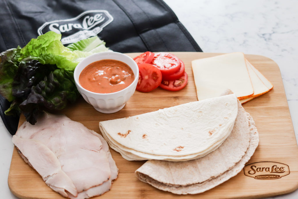 turkey tikka masala wrap ingredients - turkey, lettuce, sauce, tomatoes, cheese, tortillas