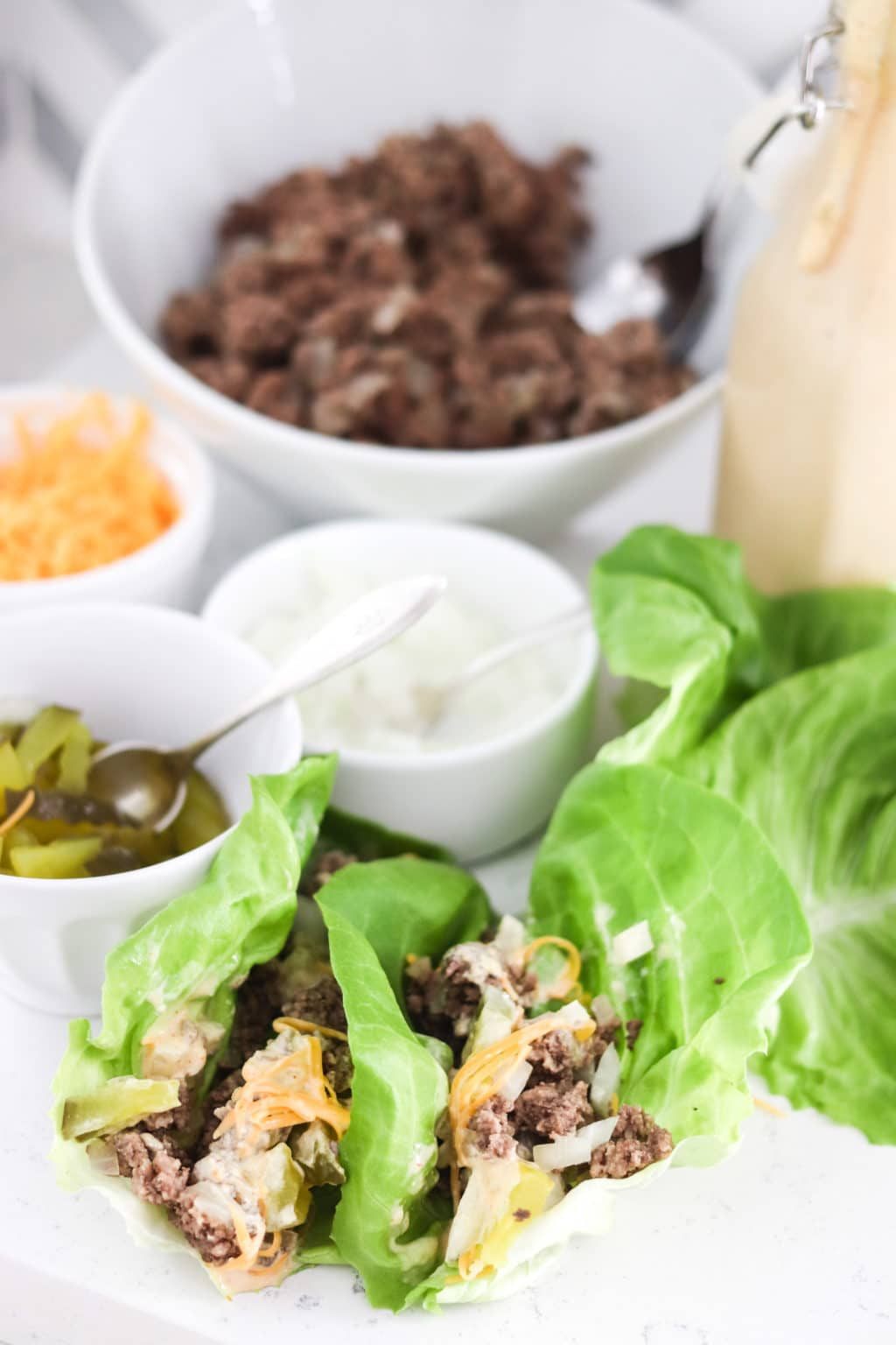 Big mac lettuce wraps setup with toppings