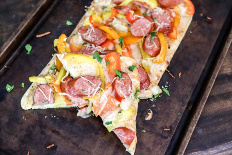 Creamy Cajun sauce, smoked sausage, peppers and onions loaded on a flatbread will make these Smoked Sausage Cajun Flatbreads a staple for lunch or dinner!