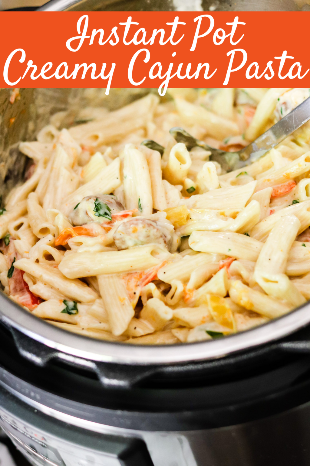 Instant Pot Creamy Cajun Pasta is filled with spicy smoked sausage and bell peppers, then drenched in a homemade cheesy sauce! Dinner is ready in minutes!