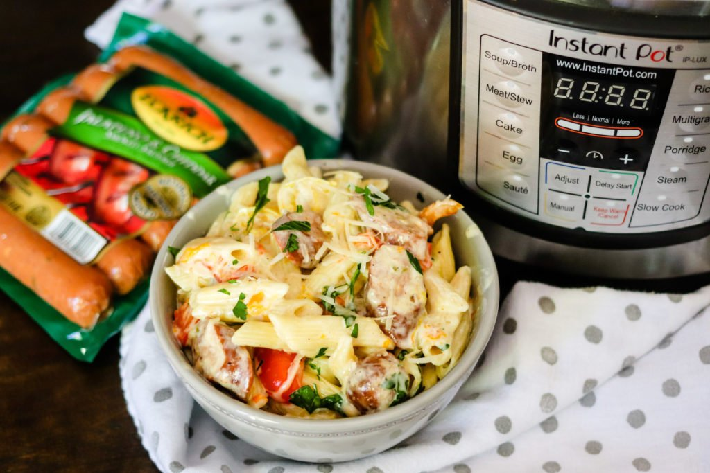 Instant Pot Creamy Cajun Pasta is filled with spicy sausage and bell peppers, and then drenched in a homemade cheesy sauce! Dinner is ready!