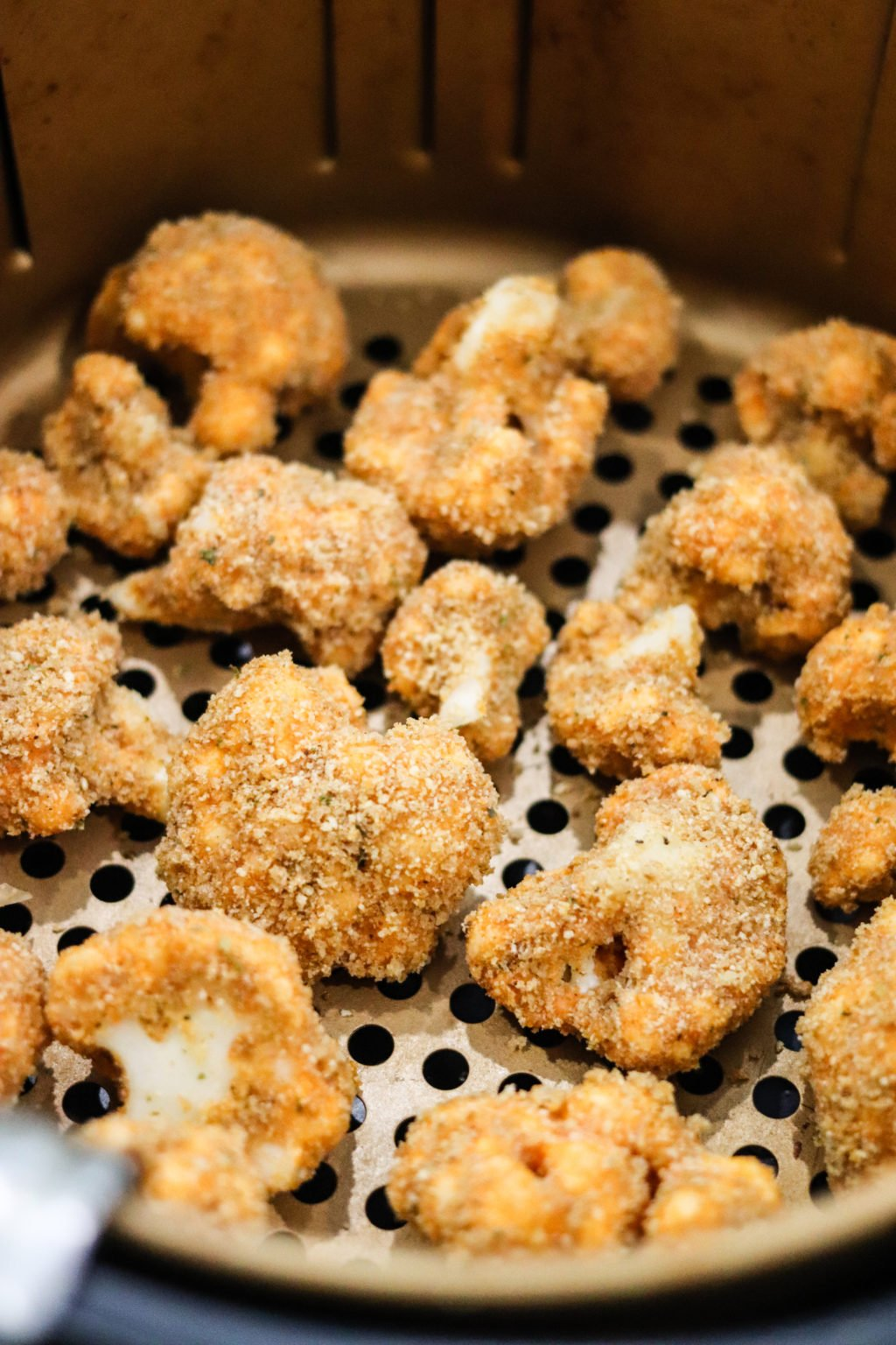Air Fryer Buffalo Cauliflower Bites inside air fryer up close