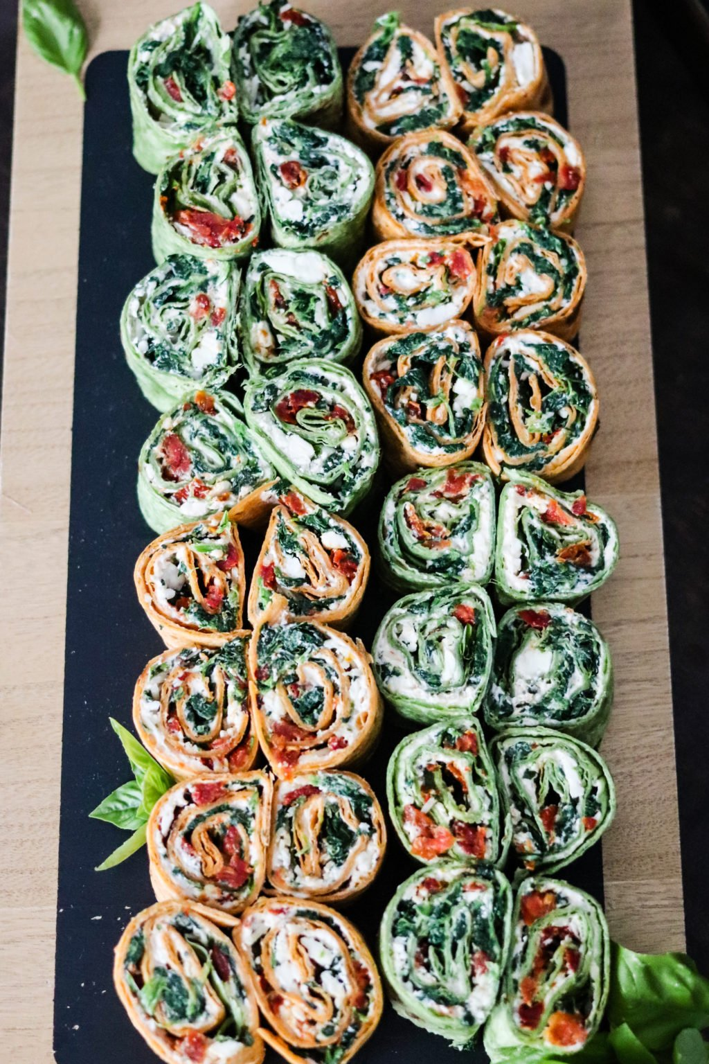 Mediterranean Pinwheels are an easy vegetarian appetizer! Stuffed with 3 cheeses, spinach, sun-dried tomatoes, and fresh basil, they are a HUGE crowd pleaser! With VEGAN and LOW CARB options as well!