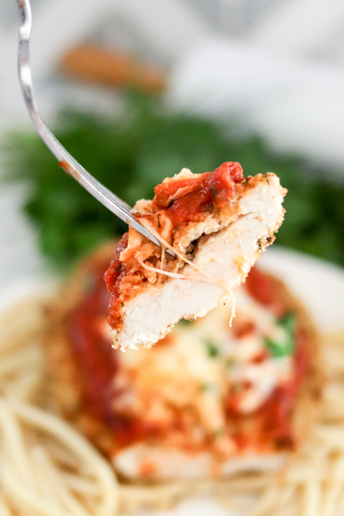 Air Fryer Chicken Parmesan is delicious and healthier than the traditionally fried version. This meal is done in less than 15 minutes, and the chicken is moist and full of flavor!