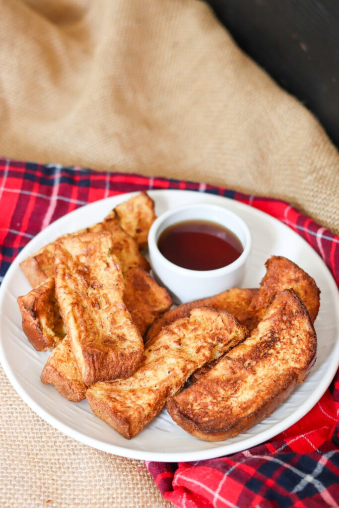 Homemade Air Fryer French Toast Sticks are so easy and delicious! Eat them fresh or freeze and reheat later for a quick breakfast!