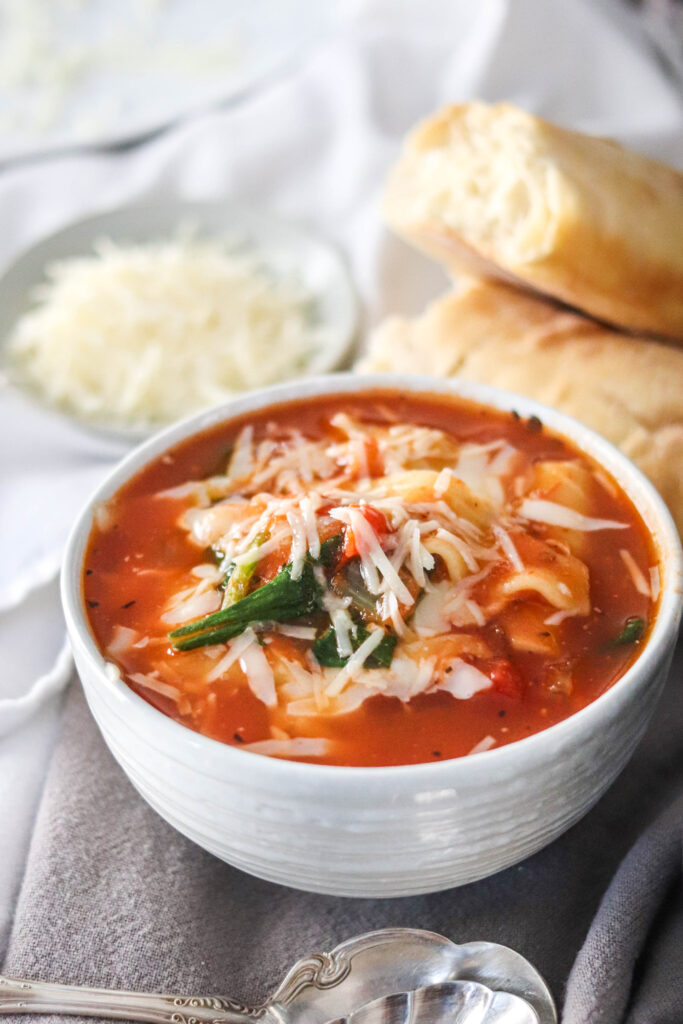 This lightened up Instant Pot Lasagna Soup is so flavorful you don't realize it's healthy! Make it vegetarian or loaded with meat, there's directions for both!! Only 193 calories per serving!