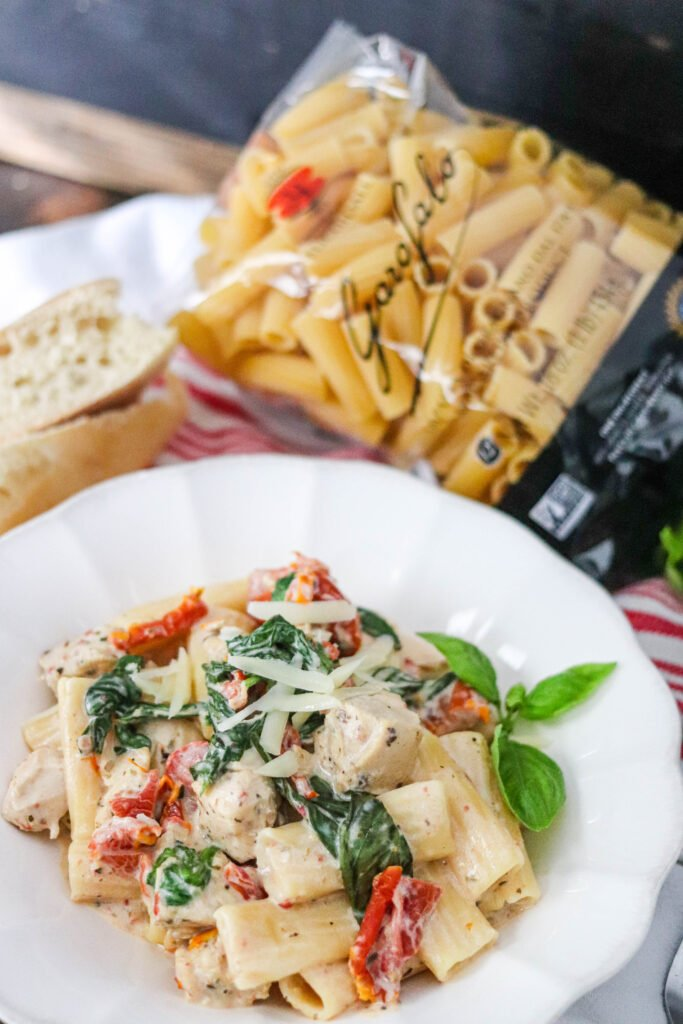 Instant Pot Tuscan Chicken Pasta is the perfect easy meal! Packed with pasta, spinach, sun-dried tomatoes, and chicken in an ultra creamy sauce makes this over-the-top delicious!