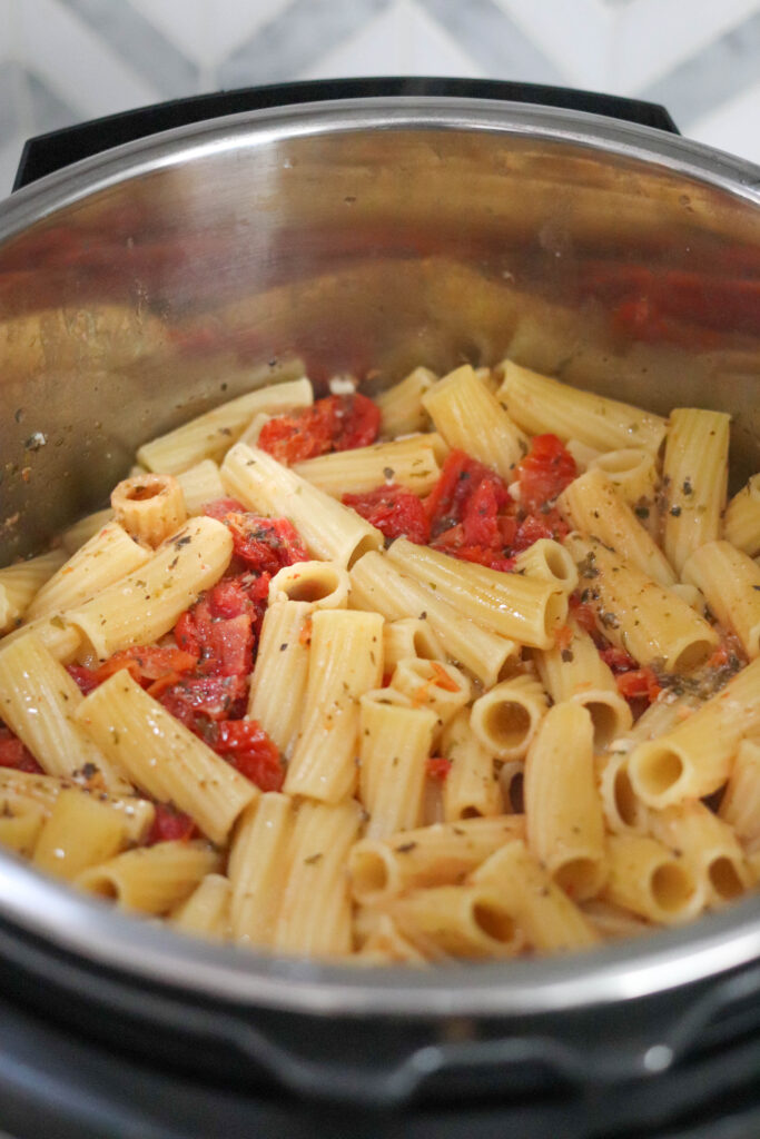 cooked tuscan chicken pasta before cheese is added