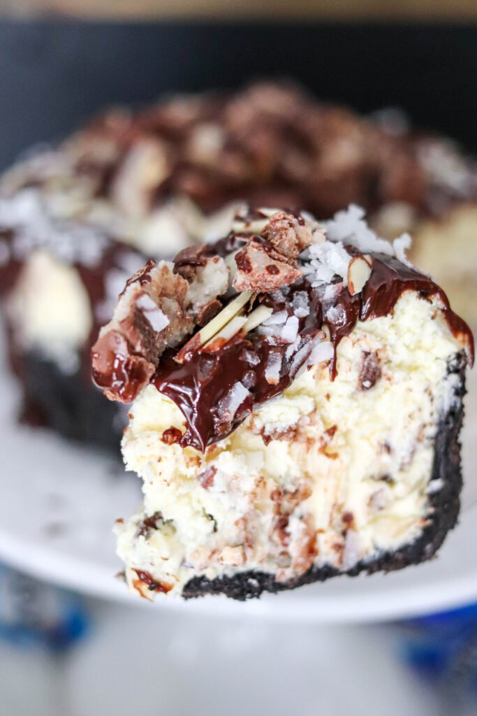 slice of almond joy cheesecake
