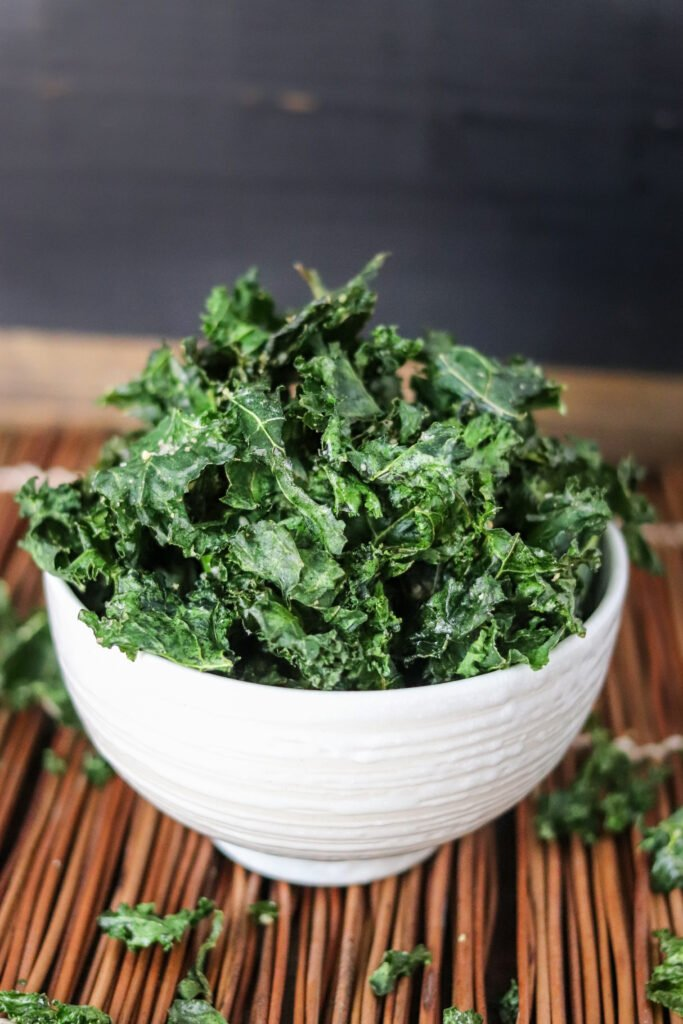 Air Fryer Kale Chips are the easiest and most delicious Kale Chips! Made in just minutes and super healthy (63 calories per serving), these will be your go-to snack!